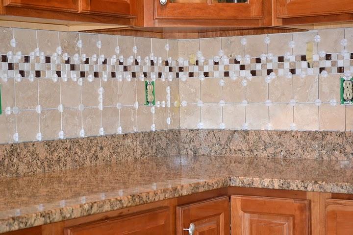 freshly tiled kitchen backsplash with spacers still installed how to tile a backsplash